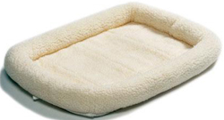 """<ul> <li><span class=""""blackbold"""">Quiet Time Pet Bed - 54""""L x 37""""W</span> <li>Ideal for Use in Crates, Carriers & Doghouses <li>Keeps Pets Cool in the Summer, Warm in the Winter <li>Completely Machine Washable <li><span class=""""redbold"""">Ultra-Soft Synthetic Sheepskin</span> <li>Bed Color Conceals Shedding </ul>"""